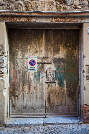 An old wooden door of a house in Cefalu, Sicily