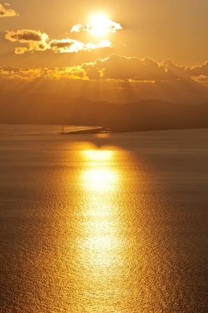 a sun in the dusk is falling on Ganzirri  Straits of Messina   photo
