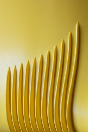 sinuous parallel lines in yellow plastic. Stock Photo - 14799726