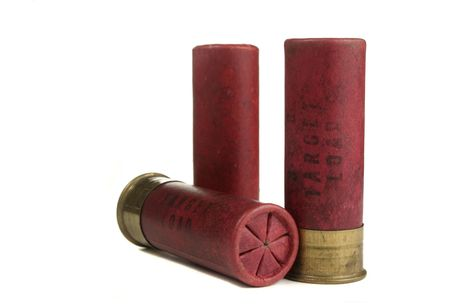Vintage paper shotgun shells. Isolated on white.
