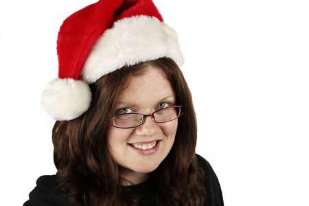 Young woman in a Santa hat. Isolated on white.