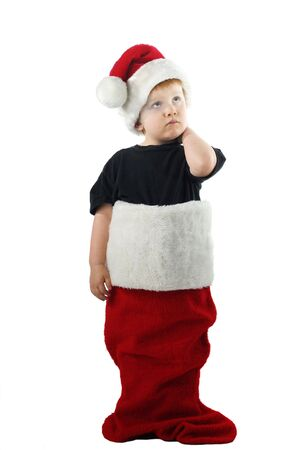 Young boy in a large Christmas stocking. Isolated on white.