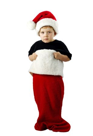 Cute boy in a large Christmas stocking. Isolated on white.