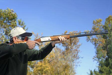 Man bird hunting or shooting skeet. Stock Photo