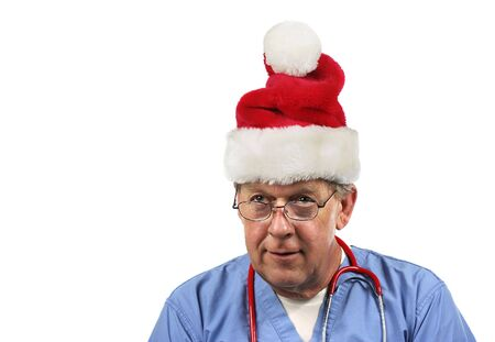 Surgeon in a Santa hat. Isolated on white.