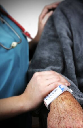 Hospital bracelet on a senior man. Shallow depth of field