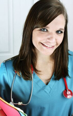Portrait of a nurse with charts