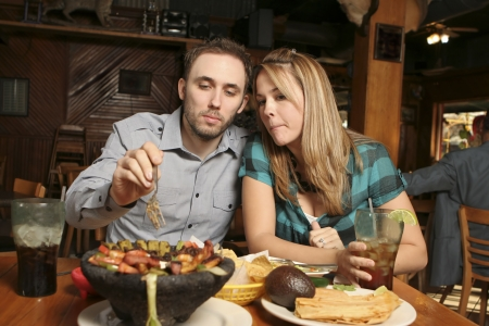 Couple dining at a Mexican restaurant. Shallow dof with background and foreground blurred