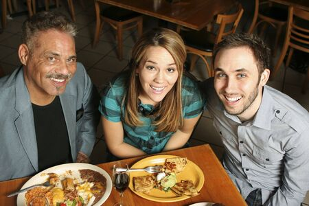 High angle shot of three people dining at a Mexican restaurant. Stock Photo
