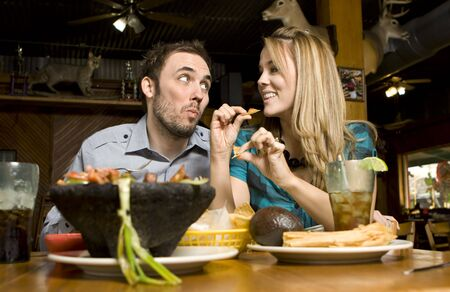 Cute Couple Eating Chips Stock Photo