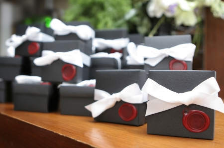 Close up of wedding favors with wax seal. Add your own letter or logo.  Shallow depth of field with only the closest box in sharp focus. photo