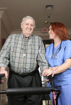 Senior adult with his walker and nurse assisting.