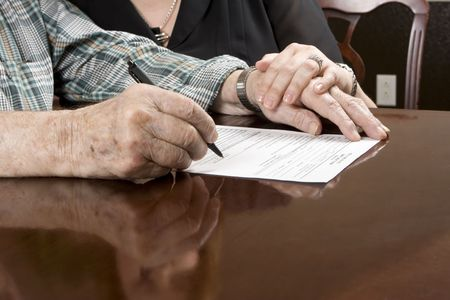 Daughter helping senior father with paperwork