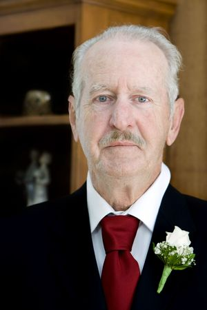 Senior male attending his daughters wedding Stock Photo