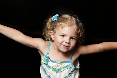 Cute blonde girl on dark background