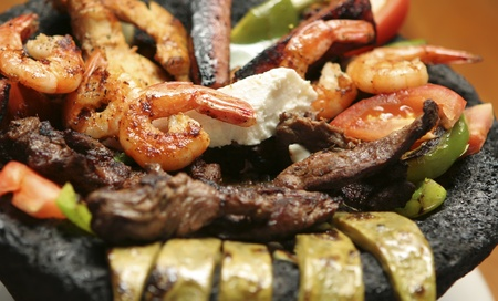 Close up of a molcajete with mexican cuisine