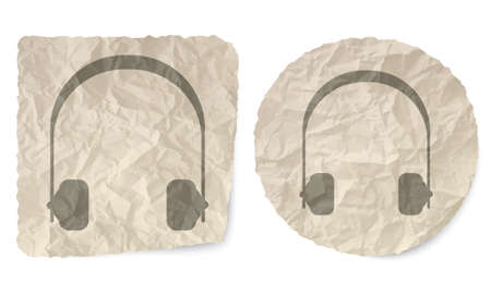 wrinkled: Crumpled slip of paper and a headphones