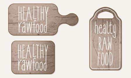 breadboard: Wooden breadboard and inscription healthy raw product