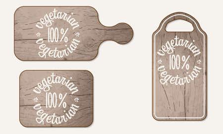 breadboard: Wooden breadboard and inscription vegetarian product