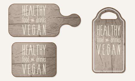 breadboard: Wooden breadboard with the words healthy, food, drinks; vegan
