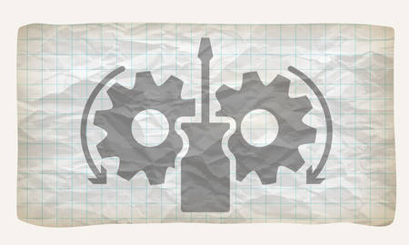 graph paper: Crumpled graph paper with screwdriver and cogwheels