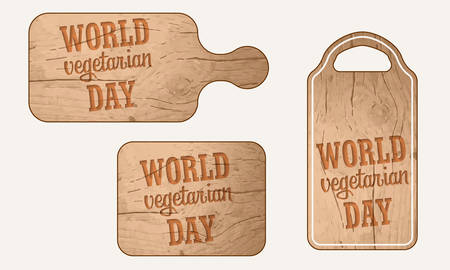 breadboard: Wooden breadboard with the words world vegetarian day