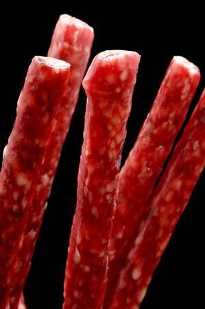object on black - food smoked sausage  Stock Photo