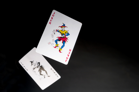 flying playing cards on a dark background- Two Jokers