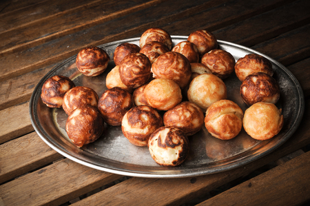 donut balls on a metal tray on dark Stock Photo - 116537360