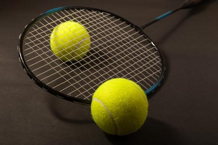 tennis ball and racket on dark background Stock Photo