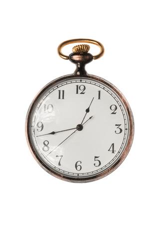 Antiguo reloj de bolsillo aislado sobre fondo blanco. Foto de archivo