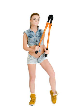 belly button girl: Young female worker with a bolt cutter