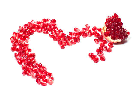 a pomegranate: Heart shaped pomegranat isolated with with backgrounnd
