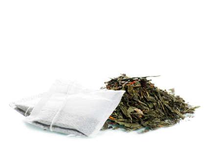Black tea and tea bag macro isolated on white photo