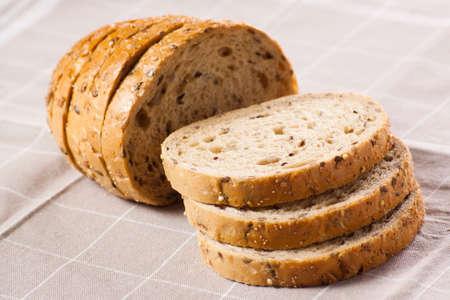 Bread on the brown napkin. Stock Photo - 18169884