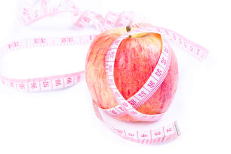 Apple and measuring tape isolated on white. photo