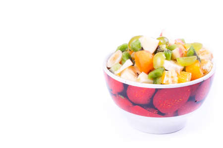Plate of a tasty cuted fruits isolated on a white. photo