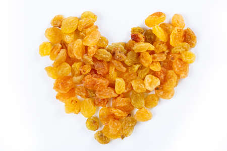 sultanas: Heart from sultanas on white  Stock Photo