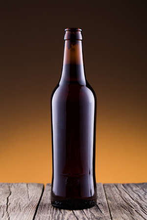 condensate: Beer bottle on a wooden table Stock Photo