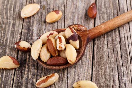 Brazil nuts on a wooden spoon. Zdjęcie Seryjne