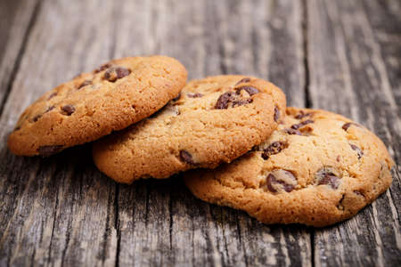 chocolate chip cookie: Tasty cookies on a wooden table. Stock Photo