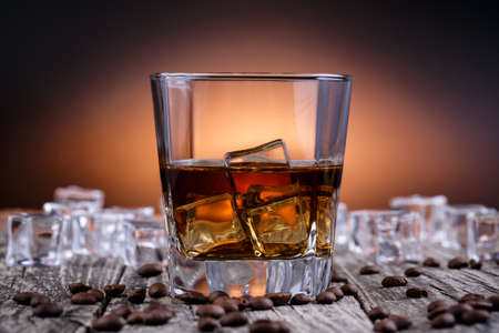 Alcohol on a wooden table with coffee beans. photo