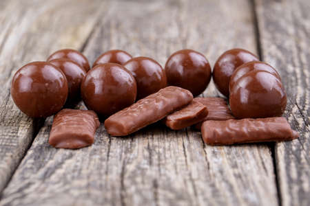 junk food: Delicious chocolate candies on a white .