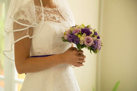 voile: Beautiful brides wedding bouquet with roses.