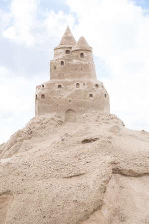 sandcastle: Sandcastle at skies background in summer.