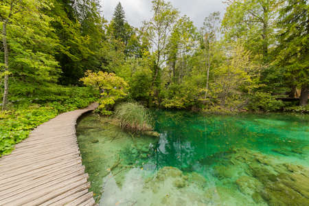 Wooden path in National Park in Plitvice in Croatia. Stock Photo