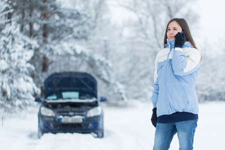 snow woman: Winter car breakdown - woman call for help.