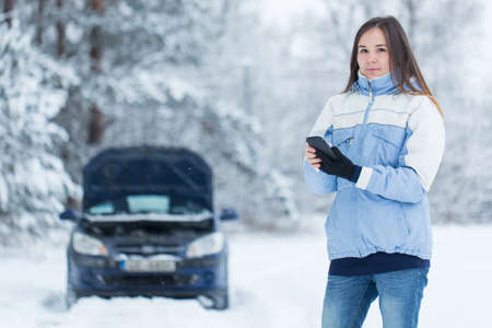 motor vehicle: Winter car breakdown - woman call for help.