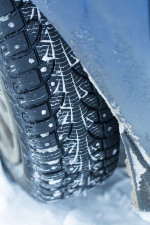 winter tires: Car tires on winter road.