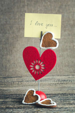 about you: I love you handwritten on memo holder with ginger cookies. Stock Photo